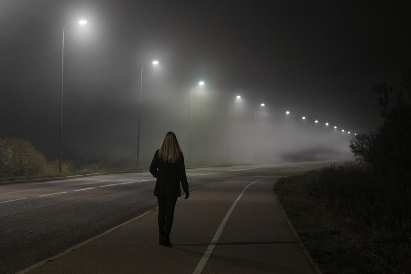 A woman on a misty road