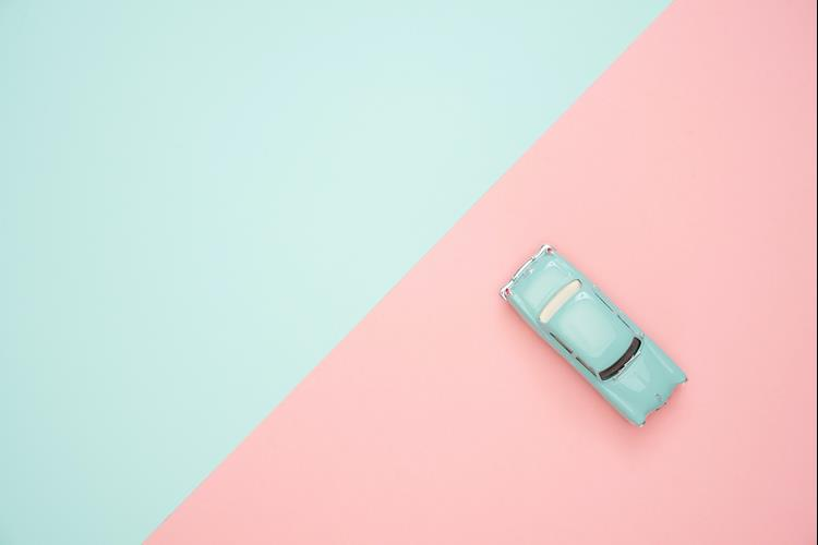 A car on a pastel colour background